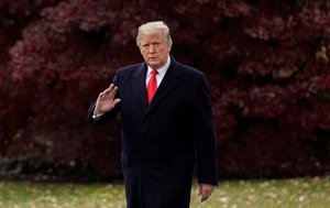 U S  President Donald Trump walks to board the Marine One helicopter to begin his travel to Mississippi from the White House in Washington. REUTERS Jonathan Ernst File Photo