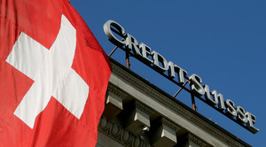 FILE PHOTO: Switzerland's national flag flies next to the logo of Swiss bank Credit Suisse at a branch office in Luzern, Switzerland October 19, 2017. REUTERS/Arnd Wiegmann/File Photo GLOBAL BUSINESS WEEK AHEAD