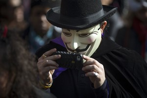 Person dressed in a Guy Fawkes mask takes part in the Childrens Halloween day parade at Washington Square Park in the Manhattan borough of New York