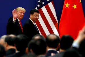 FILE PHOTO U S President Donald Trump and China s President Xi Jinping meet business leaders at the Great Hall of the People in Beijing China November 9 2017 REUTERS Damir Sagolj File Photo