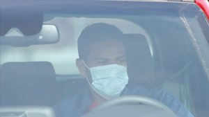 Lodi, el jugador del Atlético de Madrid, se dirige a pasar las pruebas médicas.