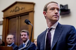 Facebook CEO Mark Zuckerberg arrives for a House Financial Services Committee hearing on Capitol Hill in Washington, Wednesday, Oct. 23, 2019, on Facebook's impact on the financial services and housing sectors. (AP Photo/Andrew Harnik)