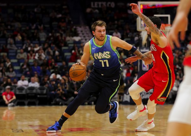 Dec 3, 2019; New Orleans, LA, USA; Dallas Mavericks forward Luka Doncic (77) drives past New Orleans Pelicans guard JJ Redick (4) during the first quarter at the Smoothie King Center. Mandatory Credit: Derick E. Hingle-USA TODAY Sports