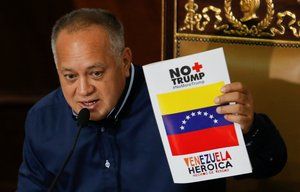 Venezuela s National Constituent Assembly President Diosdado Cabello holds a banner reading No more Trump Heroic Venezuela during a session in Caracas Venezuela August 12 2019 REUTERS Manaure Quintero