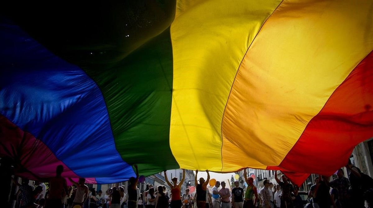 lmmarco22812167 people wave a giant rainbow flag during the gay pride parade170609201029