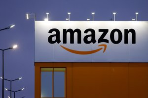 FILE PHOTO: The logo of Amazon is seen at the company logistics center in Lauwin-Planque, northern France, February 20, 2017. REUTERS/Pascal Rossignol/File Photo