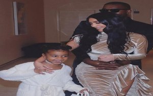 Kim Kardashian, Kanye West y su hija North West.