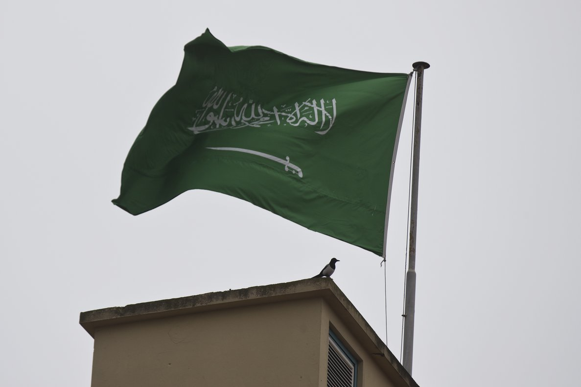 A bird sits by a Saudi Arabia s flag on the roof top of Saudi Arabia s consulate in Istanbul  Writer Jamal Khashoggi vanished after he walked into the consulate on Oct  2   AP Photo Petros Giannakouris