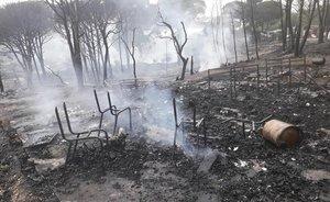 El asentamiento de inmigrantes de Palos de la Frontera (Huelva), tras el incendio que ha asolado 67 chabolas.