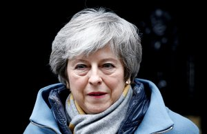 FILE PHOTO: British Prime Minister Theresa May walks outside Downing Street, as she faces a vote on Brexit, in London, Britain March 13, 2019. REUTERS/Henry Nicholls/File Photo