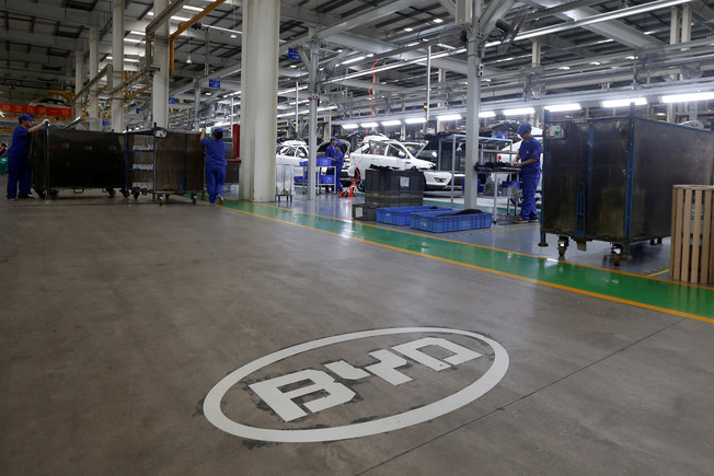 FILE PHOTO: A logo of BYD is painted inside an assembly line of the automobile maker in Shenzhen