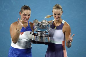Tennis - Australian Open - Women's Doubles Final - Melbourne Park, Melbourne, Australia - January 31, 2020 Hungary's Timea Babos and France's Kristina Mladenovic celebrate with the trophy after winning the final against Taiwan's Su-Wei Hsieh and Czech Republic's Barbora Strycova. REUTERS/Edgar Su