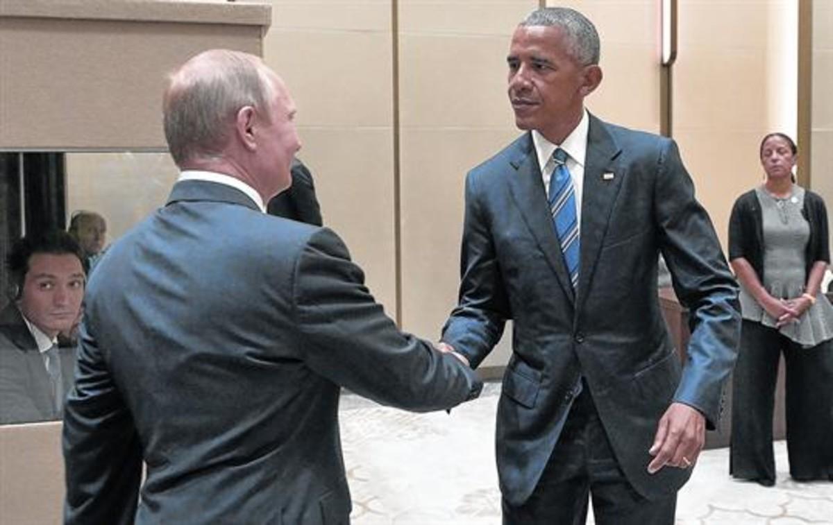 Frío saludo entre Obama y Putin, ayer en Hangzhou (China).