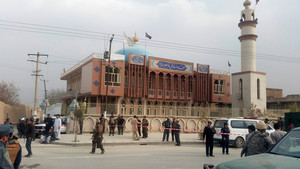 Afghan security forces keep watch in front of a mosque where an explosion happened in Kabul, Afghanistan