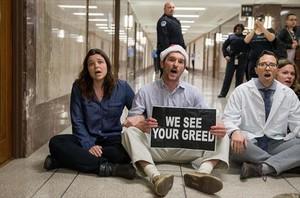 Protesta contra la reforma fiscal que pide Trump, el martes en Washington.