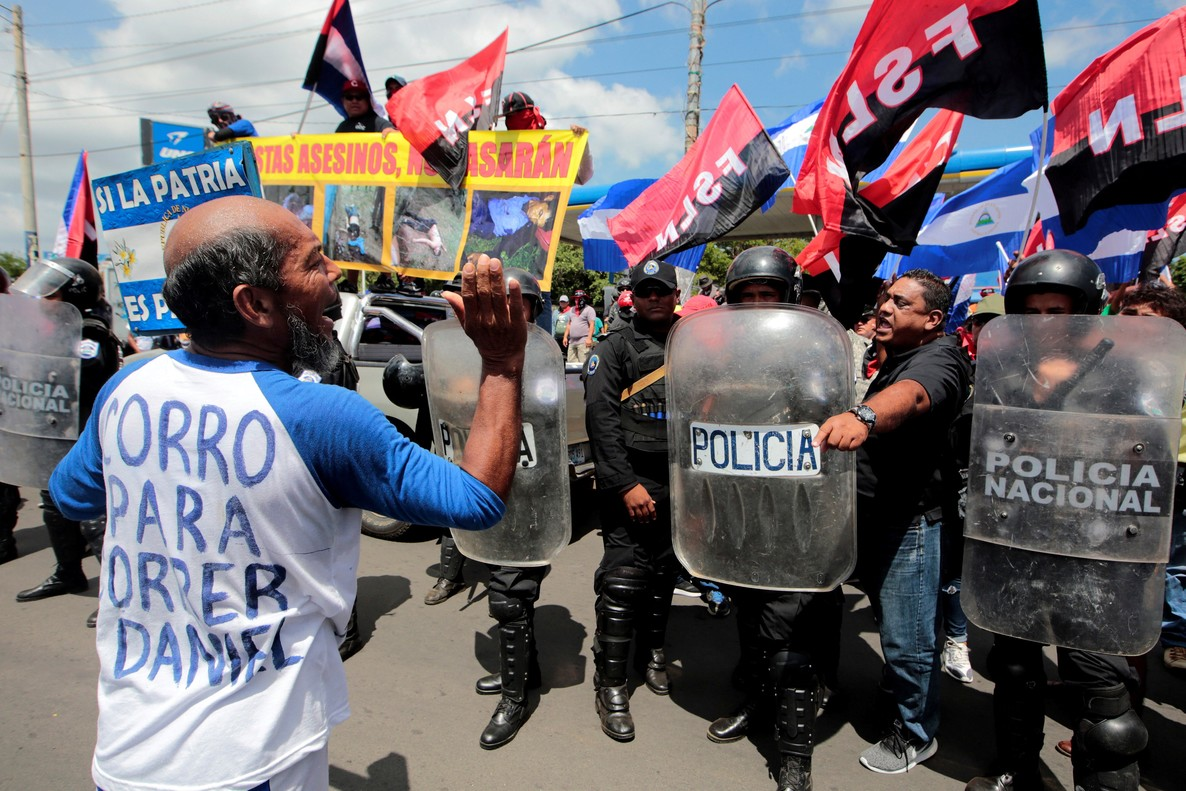 An anti-government protester shouts slogans to pro-government supporter during a march called March of the balloons in Managua Nicaragua September 9 2018 REUTERS Oswaldo Rivas
