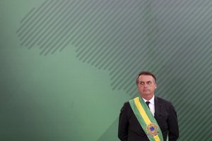 Brazil s President Jair Bolsonaro looks on as he presents his cabinet at the Planalto Presidential palace in Brasilia Brazil Tuesday January 1 2019 AP Photo Eraldo Peres