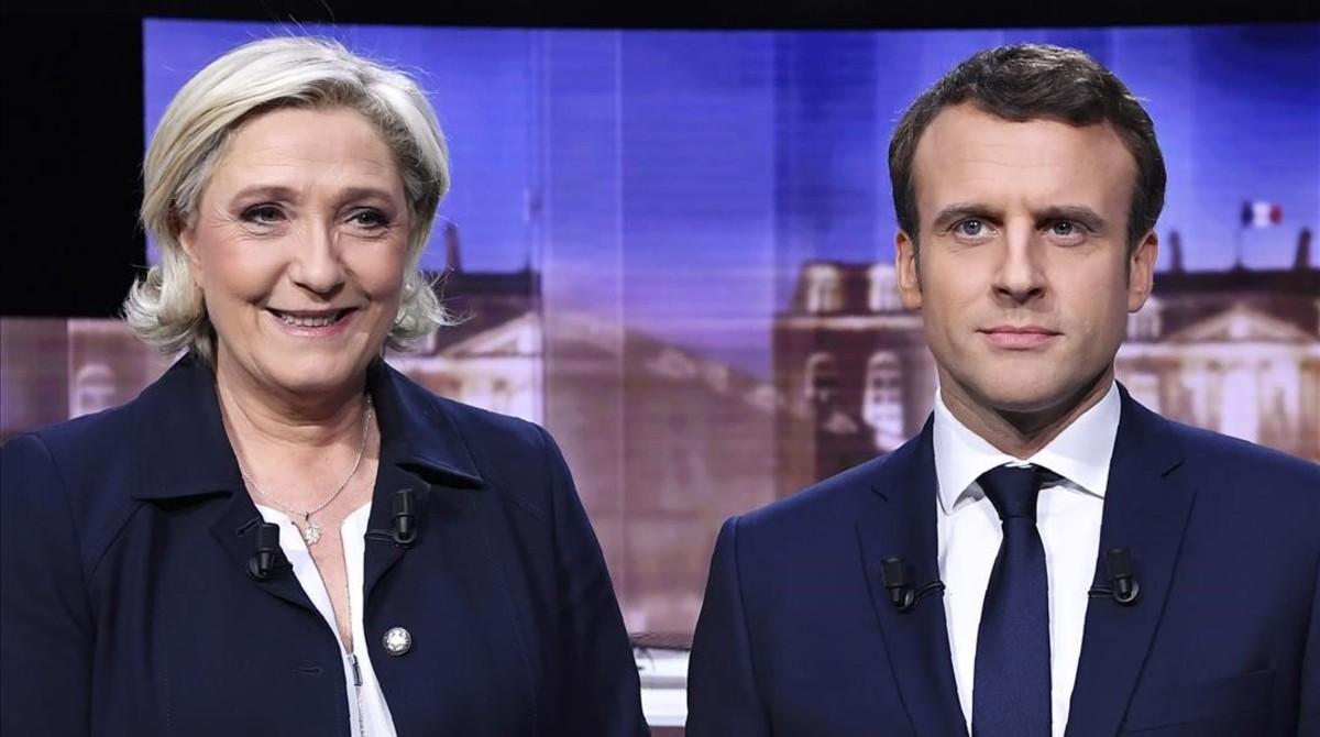 Le Pen y Macron, antes del debate televisivo, en La Plaine-Saint-Denis (norte de París), el 3 de mayo.