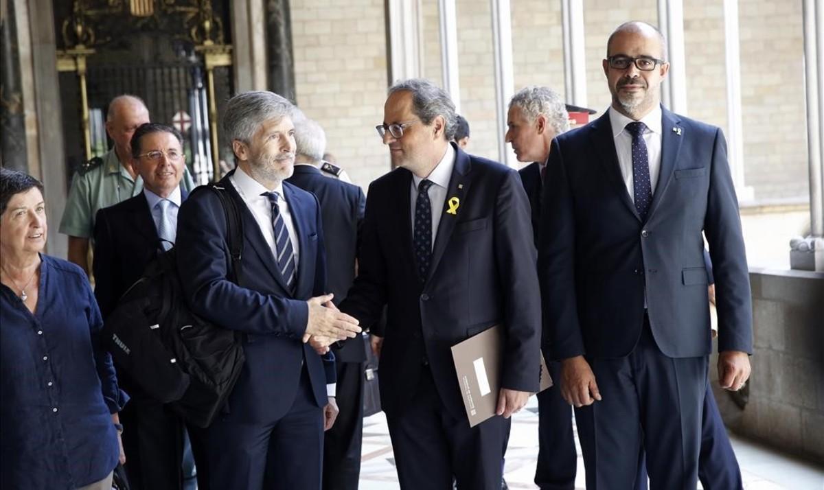 El 'president' Torra, con el 'conseller' Miquel Buch y el ministro de Interior, Grande-Marlaska.