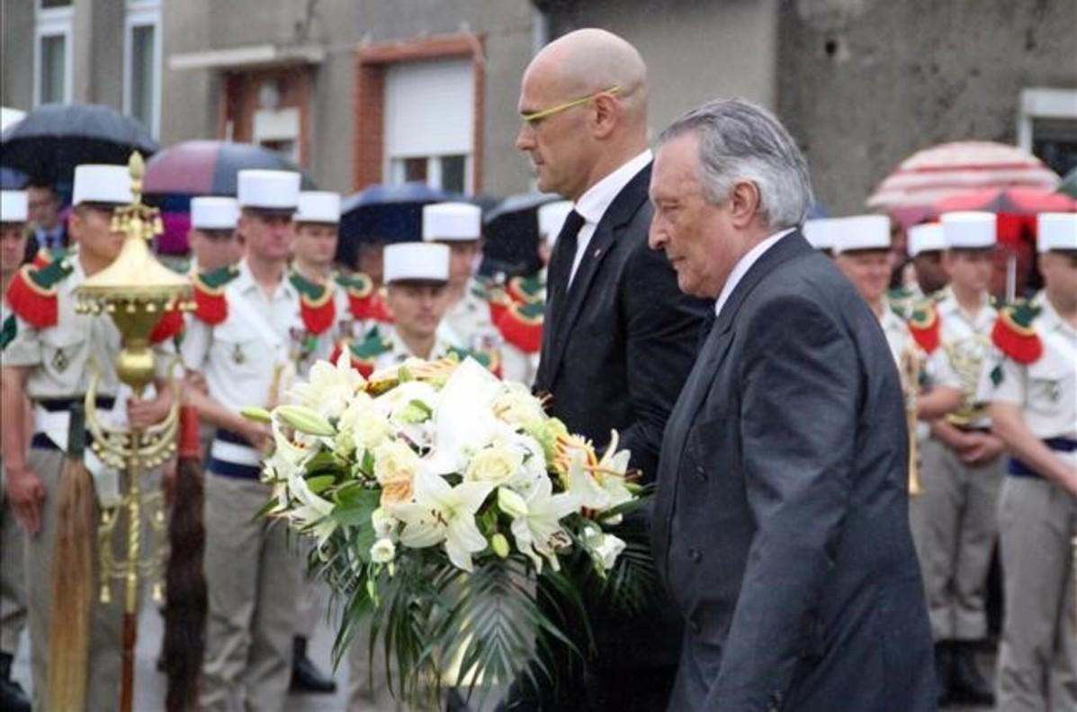 Raül Romeva y Martí Anglada, delegado de la Generalitat para Francia y Suiza, en el acto de homenaje