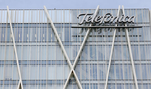 FILE PHOTO: The logo of Spains Telefonica is seen on top of their headquarters building in Barcelona