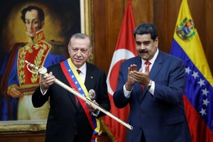 Turkish President Tayyip Erdogan holds a replica of the sword of national hero Simon Bolivar  next to Venezuela s President Nicolas Maduro  during an agreement-signing ceremony between Turkey and Venezuela at Miraflores Palace in Caracas  Venezuela. REUTERS Manaure Quintero