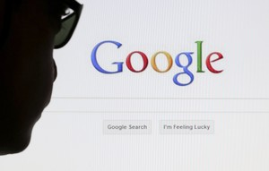 A computer user poses in front of a Google search page in this photo illustration taken in Brussels May 30 2014 Google has taken the first steps to meet a European ruling that citizens can have objectionable links removed from Internet search results a ruling that pleased privacy campaigners but raised fears that the right can be abused to hide negative information REUTERS Francois Lenoir BELGIUM - Tags POLITICS SCIENCE TECHNOLOGY