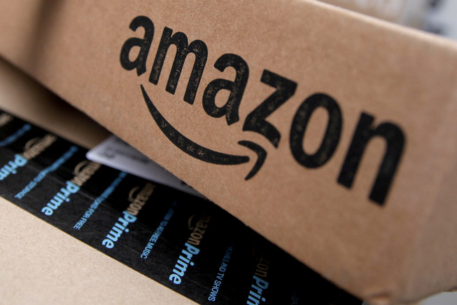 FILE PHOTO - Amazon boxes are seen stacked for delivery in the Manhattan borough of New York City