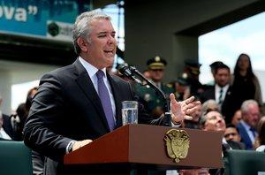 El presidente de ColombiaIvan Duqueda un discurso en la ceremonia de presentacion de la nueva cupula militaren BogotaColombiaEFE Mauricio Duenas Castaneda
