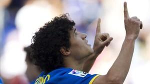 Coutinho celebra su primer gol con el Espanyolen el 'minuto Dani Jarque', el 21. 11 de marzo del 2012, Cornellà.