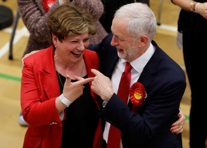 Jeremy Corbyn, leader of Britains opposition Labour Party, and Labour Party candidate Emily Thornberry gesture at a counting centre for Britains general election in London