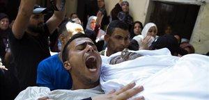 Funneral por Wael Khalifa, uno de los oficailes de policía muertos en Gaza.