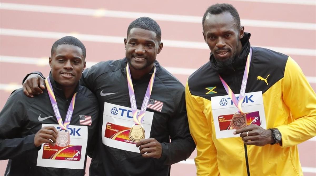 Gatlin, con Coleman (izquierda) y Bolt (derecha).