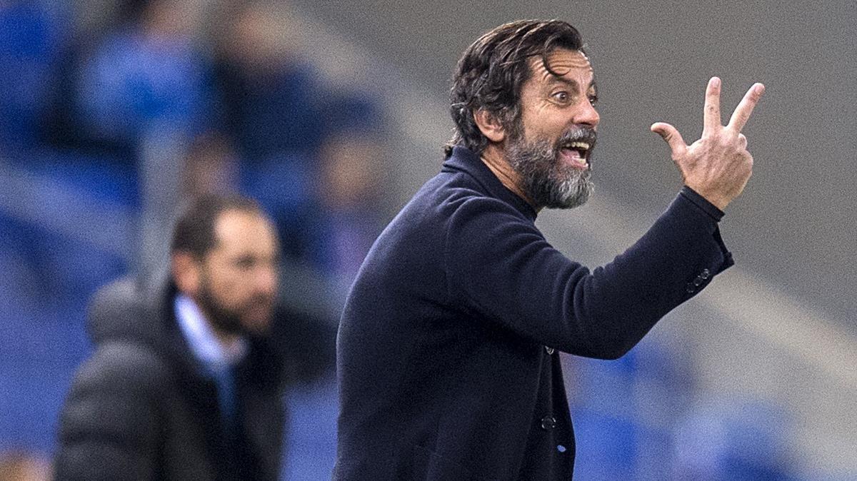Quique Sánchez Flores, con Machín al fondo, en el partido del lunes entre el Espanyol y el Girona.