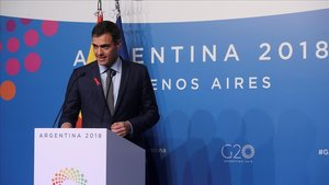 Sánchez s'anota una victòria per la inclusió del tema migratori al document final