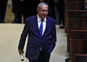 Israeli Prime Minister Benjamin Netanyahu attends a Knesset parliament  session in Jerusalem - Israeli lawmakers gave initial approval to a bill to dissolve parliament and hold early elections on April 9 and it was expected to be finalised later in the evening   Photo by Menahem KAHANA   AFP