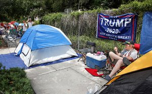 Supporters of US President Donald Trump wait along one of the main streets outside the Amway Center on June 17 2019 some 40 hours before a Trump campaign event in Orlando Florida - President Trump is expected to launch his 2020 re-election campaign here on Tuesday night Photo by Gregg Newton AFP