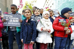 Children take part in a rally called The march against the fear, Tous Ensemble, Samen Een, All Together in memory of the victims of bomb attacks in Brussels metro and Brussels international airport of Zaventem in Brussels, Belgium, April 17, 2016. REUTERS/Yves Herman