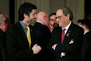 El 'conseller' de Polítiques Digitals, Jordi Puigneró, y el 'president', Quim Torra, durante el Mobile World Congress, el pasado febrero.