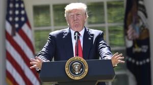 Donald Trump, anunciando su retirada del acuerdo climático de Paris.