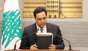 El primer ministro del Líbano, Hasan Diab, durante el discurso televisado a la nación en el que ha anunciado el impago de la deuda.