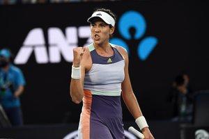Garbiñe Muguruza celebra un punto en su partido contra la ucraniana Elina Svitolina en el Abierto de Australia.