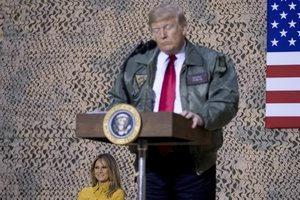 President Donald Trump speaks at a hanger rally at Al Asad Air BaseIraqWednesdayIn a surprise trip to IraqPresident Donald Trump on Wednesday defended his decision to withdraw U Sforces from Syria where they have been helping battle Islamic State militantsAP Photo Andrew Harnik