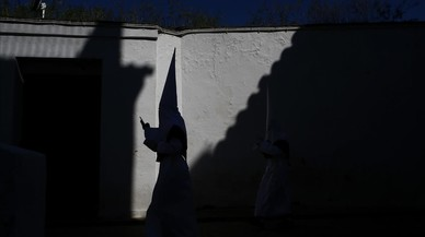 abertran42702144 a hooded penitent from the la paz brotherhood walks to the180329152813