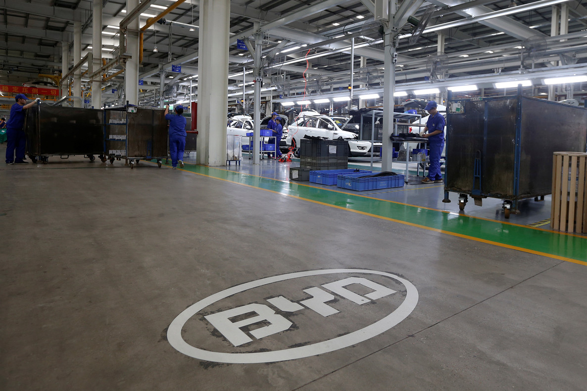 FILE PHOTO: A logo of BYD is painted inside an assembly line of the automobile maker in Shenzhen, China May 25, 2016. REUTERS/Bobby Yip/File Photo