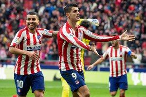 El atlético Morata (c) celebra el gol de la victoria ante el Espanyol.