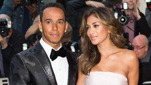 Lewis Hamilton y Nicole Scherzinger, en los premios Men of the year de 2014.