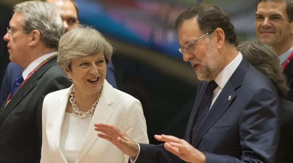 La primera ministra británica, Theresa May, y el presidente del Gobierno español, Mariano Rajoy.