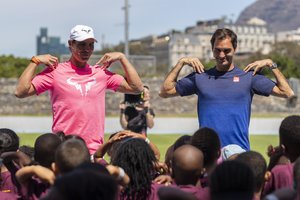 Cape Town (South Africa), 07/02/2020.- Roger Federer of Switzerland (R) and Rafael Nadal of Spain (L) take part in a Roger Federer Foundation Learning through Play session with South African children ahead of the Match in Africa Cape Town charity event, Cape Town, South Africa 07 February 2020. Roger Federer will play Rafael Nadal in the Match in Africa Cape Town charity event at Cape Town Stadium on 07 February 2020. Presented by Rolex the Match in Africa is for the benefit of the Roger Federer foundation. (Tenis, Sudáfrica, España, Suiza) EFE/EPA/NIC BOTHMA
