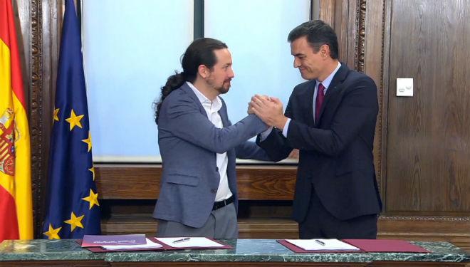 Sanchez e Iglesias en un momento del acto de presentación del programa de gobierno.